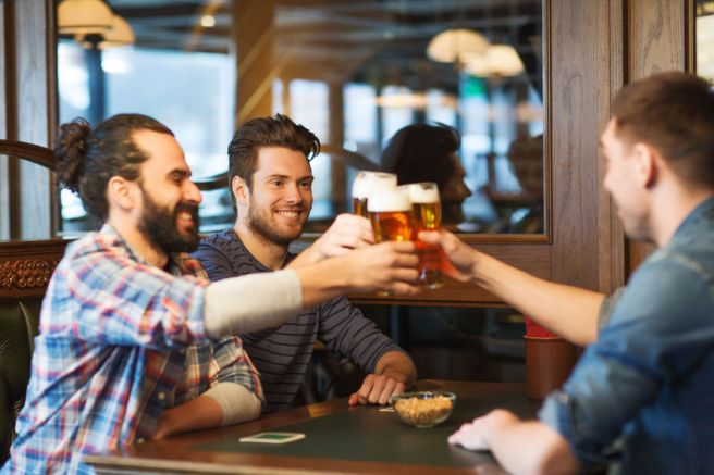 47511000 - people, men, leisure, friendship and celebration concept - happy male friends drinking beer and clinking glasses at bar or pub
